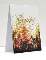 ©Candles in the Garden. Penny Black Simplicity at its Best. Repeat stamping with Distress Inks and a gold foil die-cut.