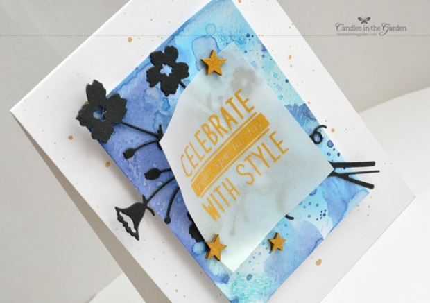 ©Candles in the Garden. RIC82 - Distress Inked panel, die-cut floral from Memory Box and Gold Perfect Pearls on Vellum.